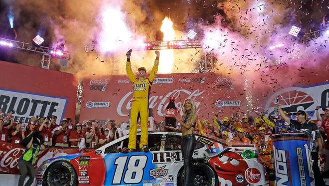 Kyle Busch celebrates after winning the NASCAR Cup Series auto race Sunday at Charlotte Motor Speedway in Charlotte, N.C.
