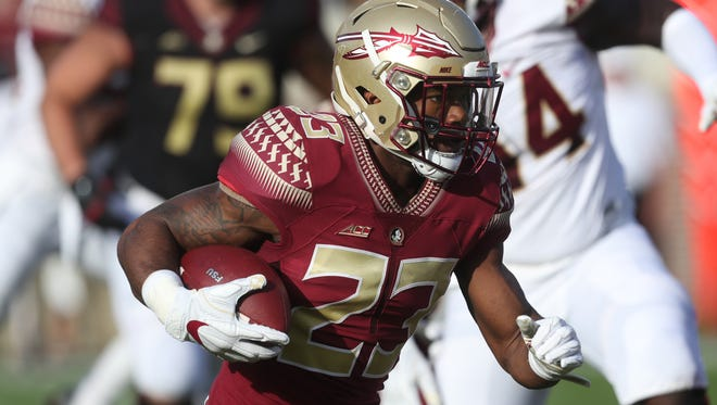 FSU's Cam Akers runs with the ball during the Garnet and Gold Spring Game at Doak Campbell Stadium on Saturday, April 14, 2018.