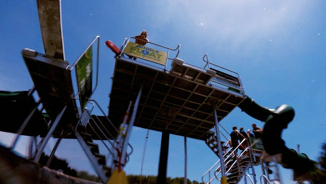 A view of the Jungle Float from the water in Rocky Point Park in Farragut, Tennessee on Thursday, June 7, 2018. Jungle Float is a floating 35-foot water park featuring a rope swing, two launching trampoline platforms, a diving board, a high-jump platform, and a water slide.