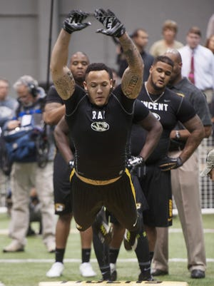 Shane Ray participates in an agility drill during Missouri's NFL football Pro Day.