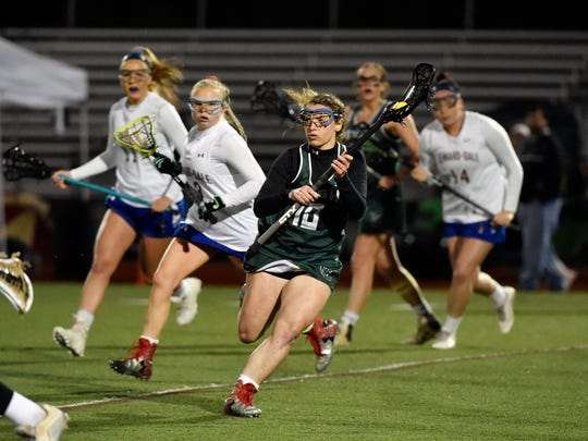 York Catholic's Bridget Sterling drives against Kennard-dale in the second half of the YAIAA girls' lacrosse title game Friday, May 12, 2017, at Central York. Kennard-Dale defeated York Catholic 12-10 for the Rams' third consecutive YAIAA championship, and their eighth in the nine years the tournament has existed.