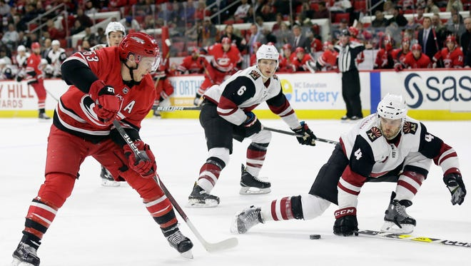 Arizona Coyotes' Niklas Hjalmarsson (4), of Sweden, blocks Carolina Hurricanes' Jeff Skinner (53) during the second period of an NHL hockey game in Raleigh, N.C., Thursday, March 22, 2018. (AP Photo/Gerry Broome)