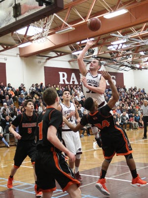 Scarsdale's Will Hoffman (32) goes over Mamaroneck's Zion Power (34) during their 61-58 win in the class AA playoff basketball game at Scarsdale High School on Saturday, February 18, 2017.
