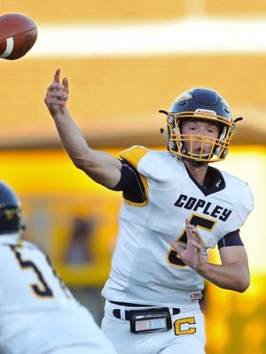 Copley quarterback Joe Reho makes a pass during the first quarter of a football game at Clifford Stadium, Friday, Sept. 4, 2020, in Cuyahoga Falls, Ohio.