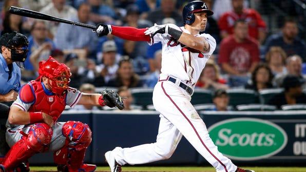 Atlanta Braves' Jace Peterson follows through on an RBI single during the eighth inning of a baseball game against the Philadelphia Phillies, Thursday, Sept. 29, 2016, in Atlanta. The Braves won 5-2. (AP Photo/Brett Davis)