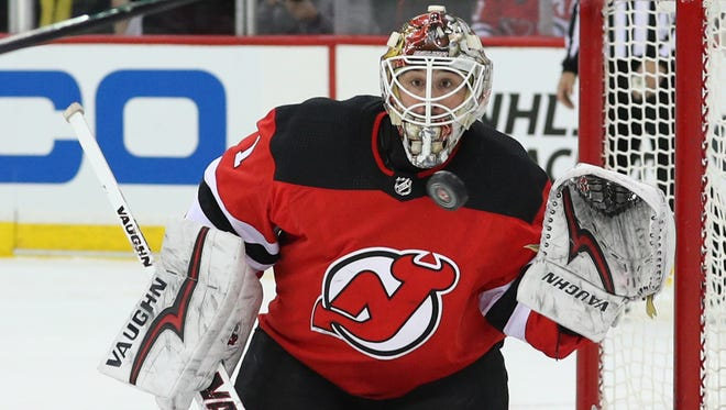Mar 31, 2018; Newark, NJ, USA; New Jersey Devils goaltender Keith Kinkaid (1) defends his net during the first period against the New York Islanders at Prudential Center.