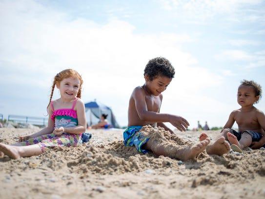 Leah O'Brien, 4, Jamauri Connyer, 5, and Kameron Smith,
