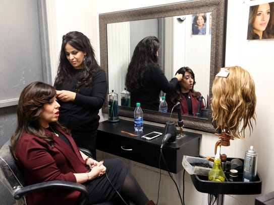 Rivkie Feiner, 44, of Monsey gets her wig done by Ayelet