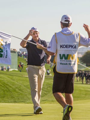 Brooks Koepka reacts to making par and winning the Phoenix Open.