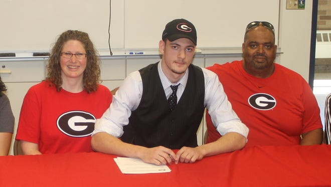 Helping Mike Edwards celebrate his signing day with the University of Georgia were family members (from left) grandmother Margaret Edwards, sister Andrea, mother Jill, father Michael and sister Jasmine.