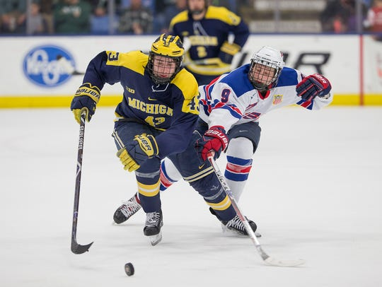 Michigan's Quinn Hughes (43), formerly of the U.S.