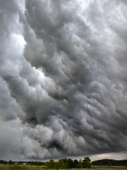 Storm clouds fill the sky near St. John's University. Warning sirens were activated in several nearby communities as the storm passed through.