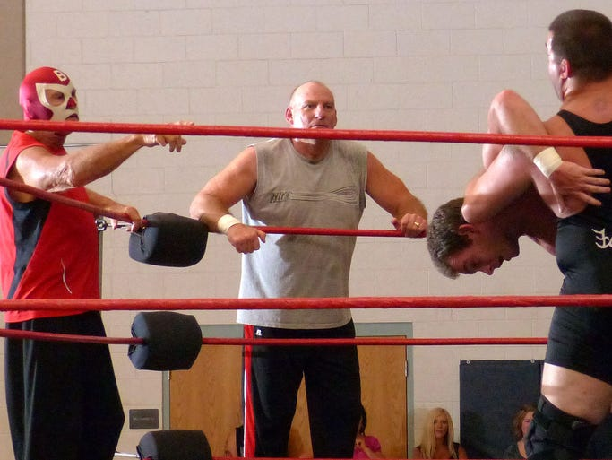 Members of the Armstrong family of wrestlers line the ropes trying to help one of their own in a tag-team, four-on-four match Saturday night as part of the 2nd annual Brad Armstrong Memorial held at the Milton Community Center.