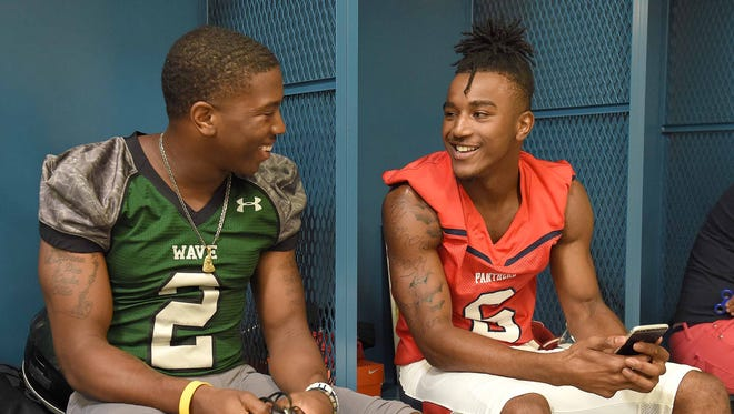 West Point athlete Marcus Murphy (left) talks with Brookhaven cornerback Jemaurian Jones in the locker room at the Dandy Dozen photo day at Mississippi Veterans Memorial Stadium in Jackson on July 26, 2017.