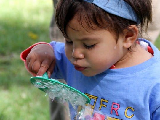 Two-year-old Roxana Rivas needs to give her bubbles