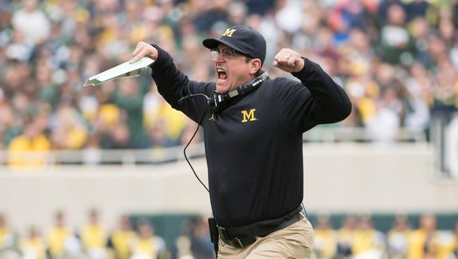 Michigan head coach Jim Harbaugh yells at the officials in the second quarter.
