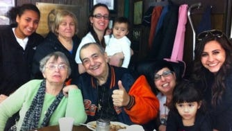 Ralph Piccolo with family members at his pizzeria in Paterson.