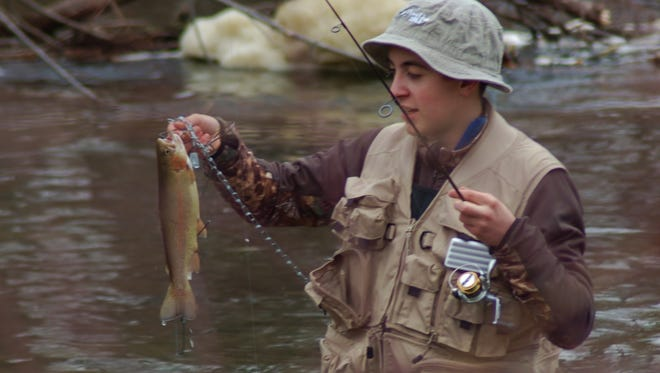 This teen was thrilled with a beautiful rainbow trout he caught during the First Opening Day.