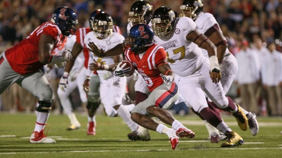 Ole Miss' Jaylen Walton (6) reverses field on his way to a 91-yard touchdown in the second half. Mississippi State played Ole Miss in a college football game on Saturday, Nov. 29, 2014 at Vaught-Hemingway  Stadium in Oxford, Miss. (Photo by Keith Warren)
