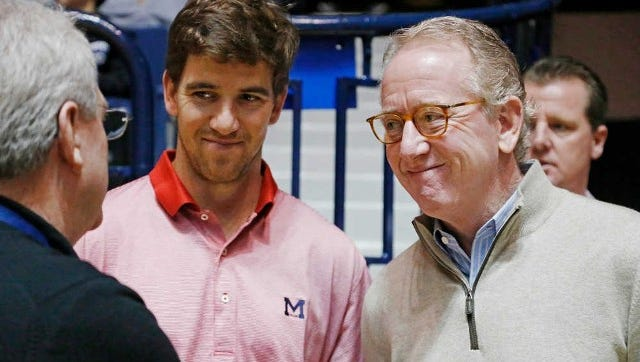 Ole Miss legend Archie Manning, right, talks with Dr. Dan Jones and his son Eli during an Ole Miss basketball game.