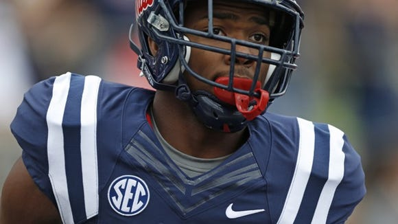 Mississippi running back I'Tavius Mathers (5) looks downfield during the first half at an NCAA college football game against Louisiana-Lafayette at Vaught-Hemingway Stadium in Oxford, Miss., Saturday, Sept. 13, 2014. No. 14 Mississippi won 56-15. (AP Photo/Rogelio V. Solis)