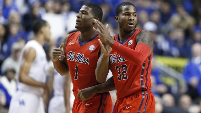 LEXINGTON, KY - JANUARY 6: Jarvis Summers #32 and Martavious Newby #1 of the Mississippi Rebels celebrate against the Kentucky Wildcats in the first half of the game at Rupp Arena on January 6, 2015 in Lexington, Kentucky. (Photo by Joe Robbins/Getty Images)