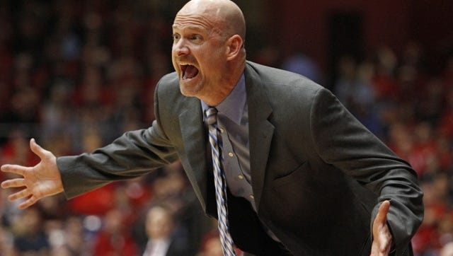 Mississippi coach Andy Kennedy shouts to his team during the first half of an NCAA college basketball game against Dayton, Tuesday, Dec. 30, 2014, in Dayton, Ohio. (AP Photo/Skip Peterson)