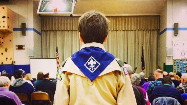 Boy Scout Colin Low, 11, of Troop 23 is ready with the microphone for voters at Richmond's Town Meeting Tuesday morning.