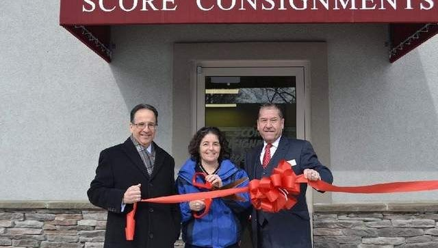 Bonnie Kremer, owner of Score Consignments, was joined by Aberdeen Economic Business Council members Bill Parness (left) and Carmine Visone at the grand opening of her new store.