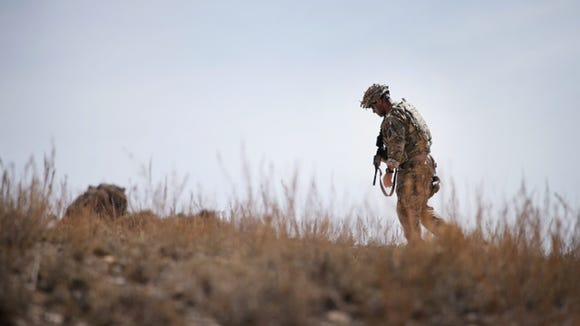 U.S. Army solider patrols the area near Pul-e Alam,