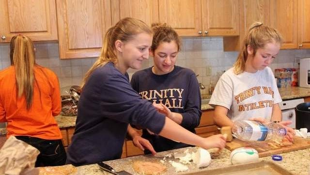 Students prepare lunch for residents of the Ronald McDonald House in Long Branch.