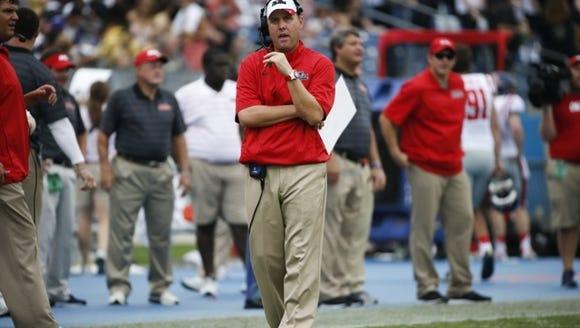 Mississippi head coach Hugh Freeze walks the sideline