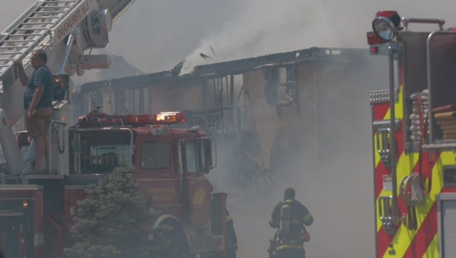 Authorities are at the scene of the multiple-alarm fire on Apollo Drive.