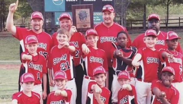 The Asheville Storm 10U baseball team and its coaches.