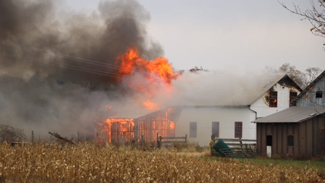 A fire near Sullivan destroyed a business Saturday. No one was injured.