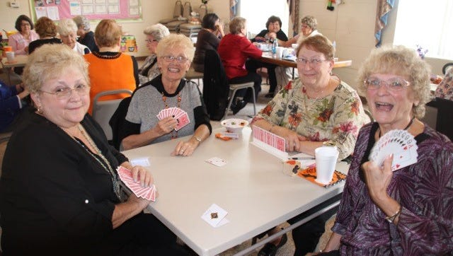 (Front, from left) Deanna Phifer, Hattie Ayres, Kathy Bennett and Carole Sahms enjoy a game day at the Millville Woman's Club on Oct. 29.