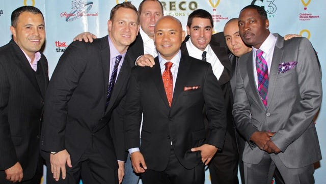 RE/MAX Our Town Agent Vincent Baricaua, center, and his friends have coordinated this event for five years.