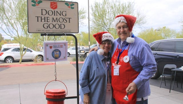 Valley real estate agents JoAnn and Joseph Callaway ringing the bell for the Salvation Army in Decemeber 2014.