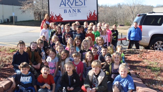 Arvest  Bank in conjunction with the Food Bank of NCA presented $2,600 collected by Cotter Schools students during the Hope for Change Drive for the Cotter Backpack Program, which will provide over 13,000 meals to Cotter Students and families in need. The second grade (pictured) collected $800 and led all of the grades and was awarded a cookout courtesy of Arvest Bank. Last year Cotter Schools finished first in the Spirit of Arkansas State Food Drive Contest and is looking to defend their title.