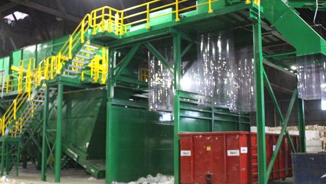 A complicated system of conveyor belts, chutes, and bailers assist Garten in recycling a million pounds of materials every week.