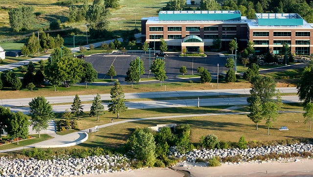 Air view of the proposed site for the Spirit of the Rivers sculpture and the mouth of Forget Me Not Creek, just north of the DOT wayside on Memorial Drive, with Aurora medical office building in background.