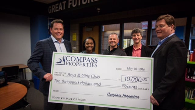 Compass Properties officials presented a donation of $10,000 to the Boys & Girls Club of the Wausau Area.