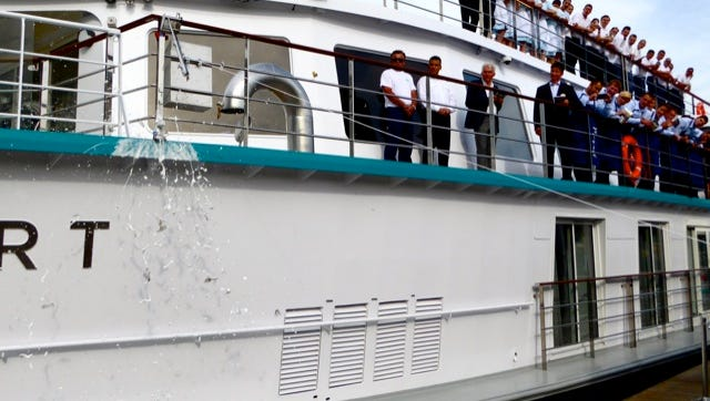 A bottle of champagne smashes against the hull of Crystal Cruises' new Crystal Mozart during a christening ceremony in Vienna on July 11, 2016.