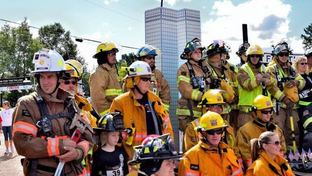 Firefighters stand in front of a replica of the twin towers during last year's Run for the Fallen in Kronenwetter.