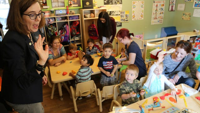 Oregon Governor Kate Brown plays with children at Loving Beginnings Friday, September 9, 2016. Loving Beginnings was the first site in Oregon to implement the Preschool Promise program, which will help 1300 kids statewide.