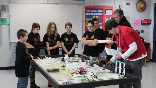The Manitowoc Wilson Junior High School LEGO team Super Omega Awesome Robots.