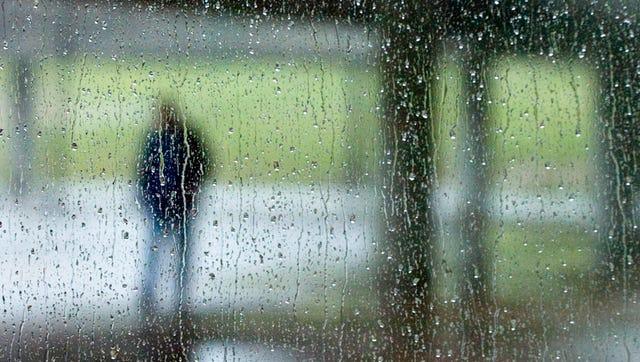 FILE - Rain falls across a window a the Civic Coliseum on Monday, February 28, 2011.