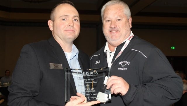 Pictured is Coach Hartley accepting the award from the MHSBCA Class 4 Vice-President Jeff Graviett from Cape Giradeau, Notre Dame.