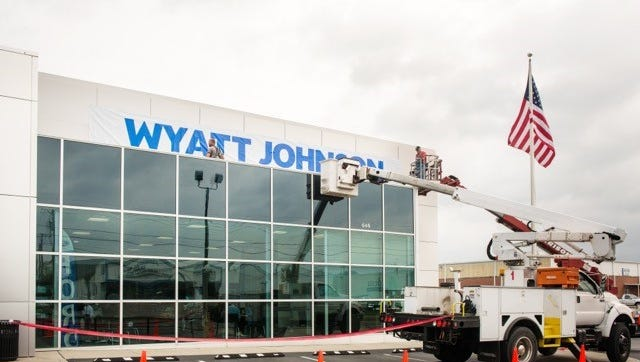 Crews changing the sign at Nashville's former Crown Ford dealership. It's now Wyatt Johnson Ford.