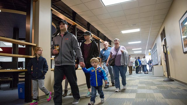 The community tours Moraine Park Technical College during an open house on Saturday. President Bonnie Baerwald announced the college's new Promise program that offers free tuition to low-income students who meet eligibility requirements. April 8, 2017.